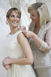 Mother Helping Bride With Wedding Dress Royalty Free Stock Photo