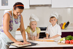 Mother Helping Chef Kids Making Food Royalty Free Stock Image