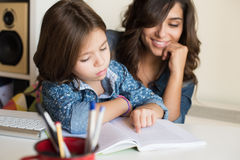 Mother helping child with homework Stock Photo