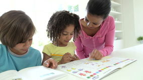 Mother Helping Children With Homework stock video