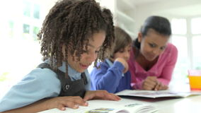 Mother Helping Children With Homework stock video footage