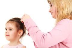 Mother Helping Daughter Stock Image