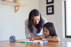 Mother helping daughter draw royalty free stock images