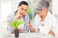 Mother helping daughter financial Stock Photo