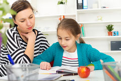 Mother Helping Daughter With Homework. Royalty Free Stock Images