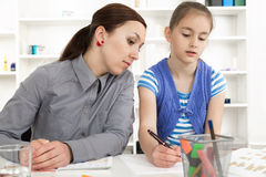 Mother Helping Daughter With Homework. Stock Image