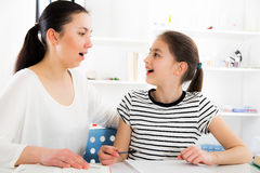 Mother Helping Daughter With Homework Royalty Free Stock Images