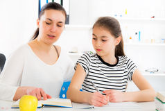 Mother Helping Daughter With Homework Stock Photos