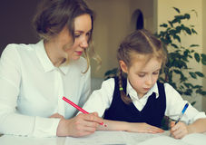 Mother helping daughter with homework. Stock Photography