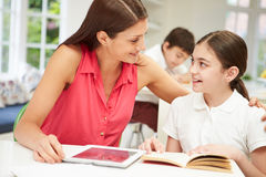 Mother Helping Daughter With Homework Stock Image