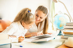 Mother helping daughter with homework Stock Photography