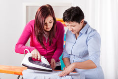 Mother helping daughter Royalty Free Stock Images
