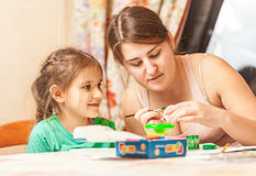 Mother helping daughter painting easter egg Royalty Free Stock Photo