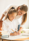 Mother helping daughter with preparing to exam Royalty Free Stock Photography