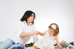 Mother Helping Daughter Stock Photos