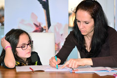 Mother helping girl to do homework Royalty Free Stock Images