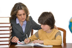 Mother helping her child with homework Royalty Free Stock Images