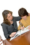 Mother helping her child with homework Stock Image