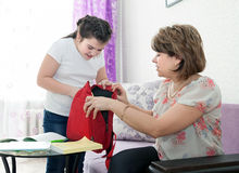 Mother helping her child with homework Stock Photography