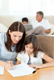 Mother helping her daughter for her homework Royalty Free Stock Photography