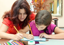Mother helping her daughter with homework Royalty Free Stock Photo