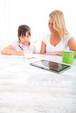 Mother helping her daughter with the homework Stock Image
