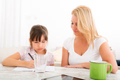Mother helping her daughter with the homework Royalty Free Stock Photography