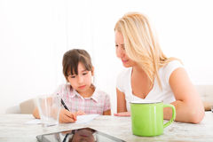Mother helping her daughter with the homework Royalty Free Stock Photo