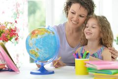 Mother helping her  daughter with homework Stock Photography