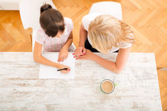 Mother helping her daughter with the homework Royalty Free Stock Images