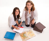 Mother helping her daughter prepare an exam Stock Photography