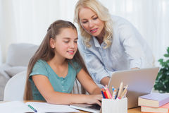 Mother helping her daughter to do homework Royalty Free Stock Photography