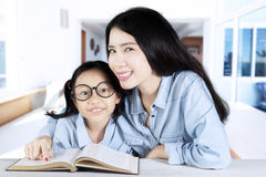 Mother helping her daughter to study at home Stock Photography