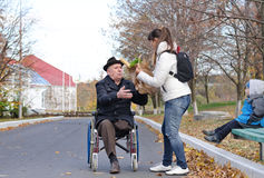 Mother helping her elderly disabled father Stock Image