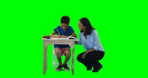 Mother helping her son while doing homework 4k stock video footage
