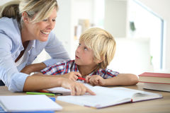 Mother helping her son with homework Royalty Free Stock Photos