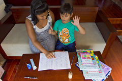 Mother helping home work Royalty Free Stock Images