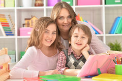 Mother helping with homework Royalty Free Stock Photo