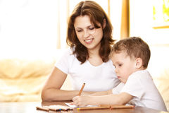 Mother helping in homework to her son Stock Image