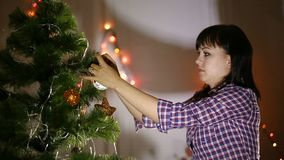 Mother with son decorating christmas tree stock footage