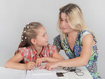Mother helping schoolkid w homework Royalty Free Stock Images