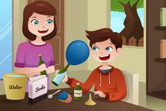 Mother helping son build a science project Royalty Free Stock Photography