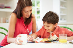 Mother Helping Son With Homework Royalty Free Stock Photography