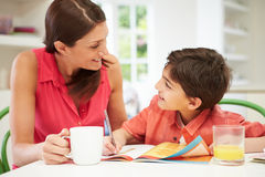 Mother Helping Son With Homework Royalty Free Stock Photos