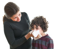 Mother helping son in sickness Stock Image