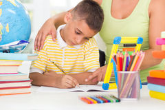 Mother helping son to do his homework Royalty Free Stock Photography