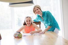 Mother helping teenaged girl with homework. A Mother helping teenaged girl with homework Royalty Free Stock Photography