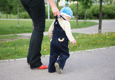 Mother helps child to go royalty free stock photography