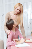 Mother helps daughter with the home work Royalty Free Stock Photography