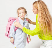 Mother helps her daughter get ready for school Royalty Free Stock Photo
